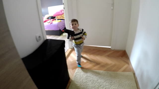 baby with a gun - toy gun stock videos & royalty-free footage