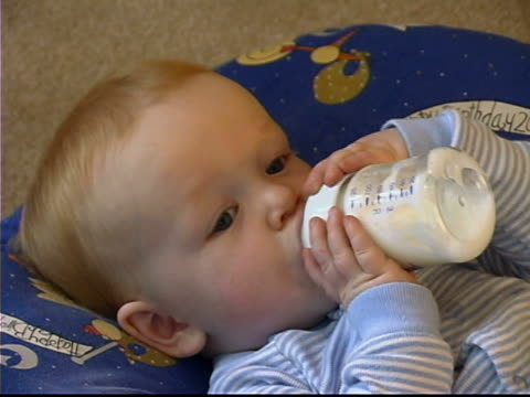 baby with bottle - unknown gender stock videos & royalty-free footage