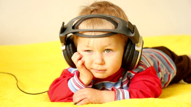 baby with headphones - one baby boy only stock videos & royalty-free footage