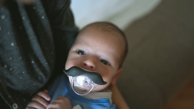 baby with mustache pacifier - pulling funny faces stock videos & royalty-free footage