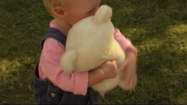 Baby with teddy bear in park
