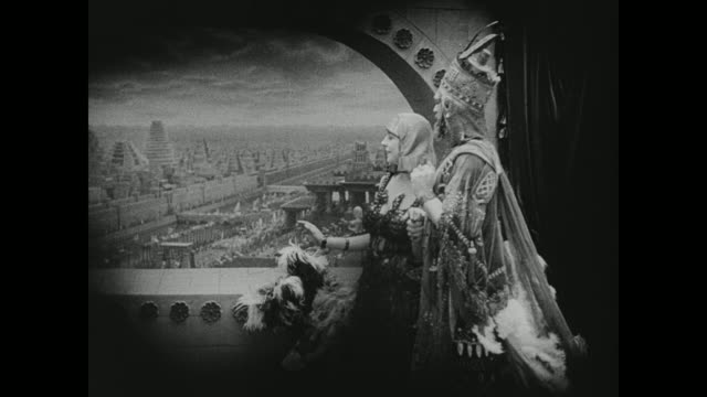 babylonian king belshazzar and princess beloved watch the city from a perch atop the gates - babylon stock videos and b-roll footage