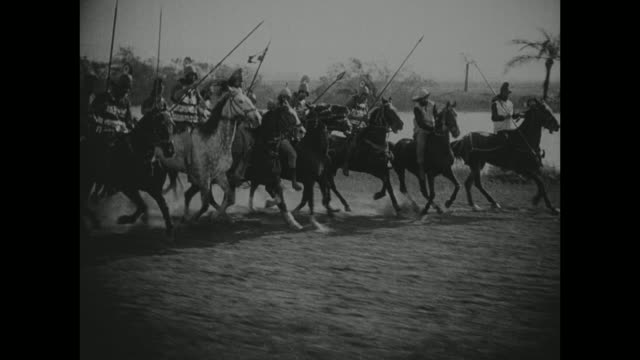a babylonian mob rides on horseback and chariots - babylon stock videos and b-roll footage