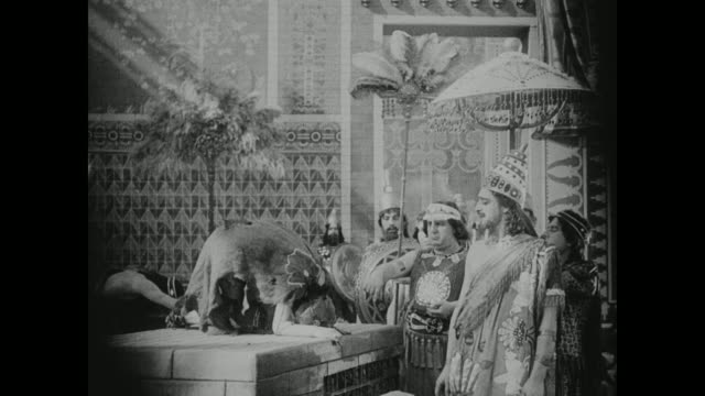 a babylonian woman is in awe of royalty - babylon stock videos and b-roll footage