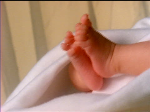 baby's feet wrapped in white blanket - cinematography stock videos & royalty-free footage