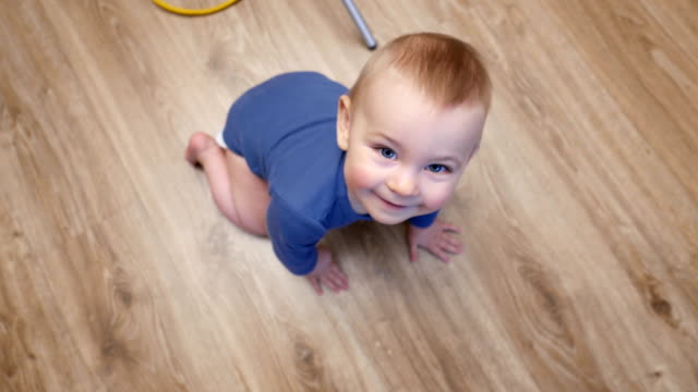 baby's first steps on floorboard, baby crawl
