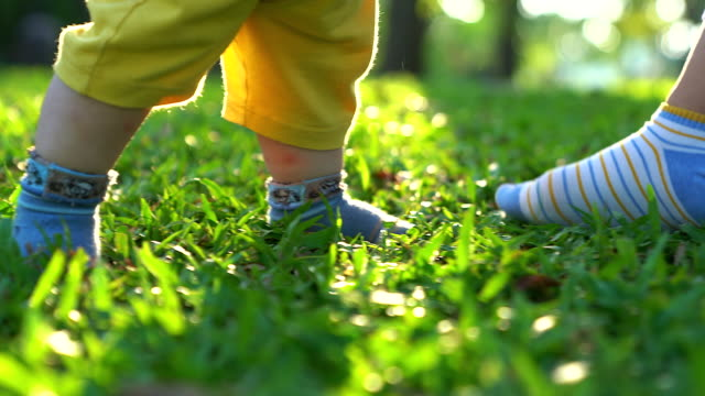 baby's first steps on the grass.the first independent steps. - steps stock videos & royalty-free footage