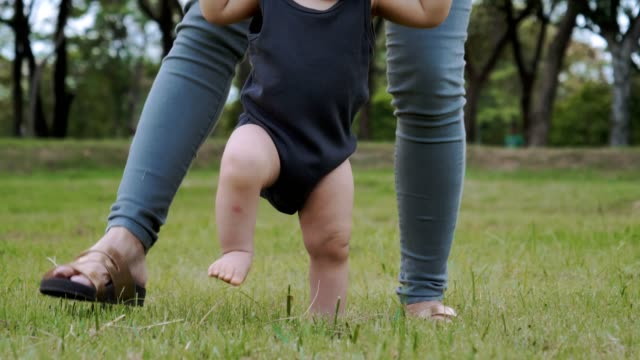 baby's first steps with his mom - 6 11 months stock videos & royalty-free footage