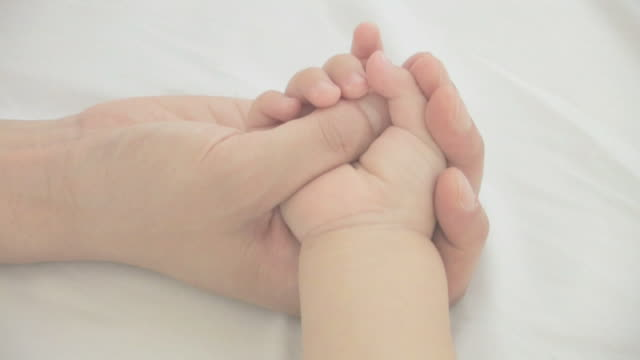 baby's hand in mother's palm - human hand stock videos & royalty-free footage