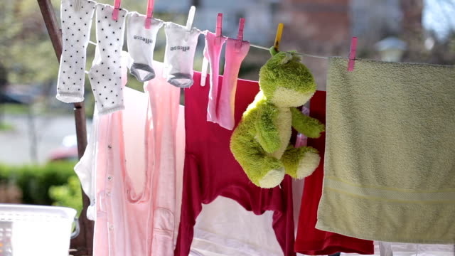 Baby's laundry is drying on a wire