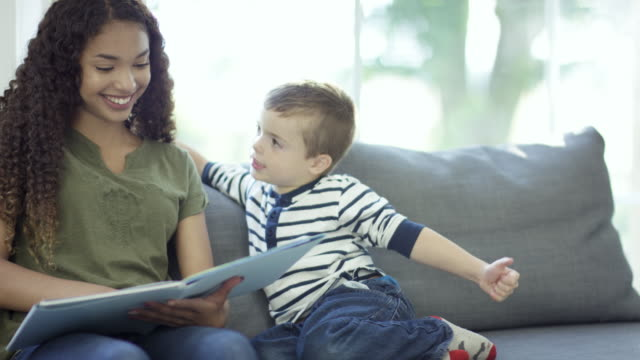 babysitter reading to boy - nanny stock videos & royalty-free footage