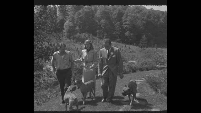 LS Bacall and Bogart exit the big house after their wedding ceremony / VS farm owner Louis Bromfield Bacall Bogart walk estate with 3 dogs / Bogart...