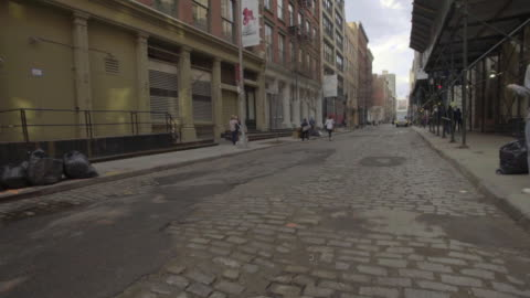 soho - back alley establishing shot - cobblestone stock videos & royalty-free footage