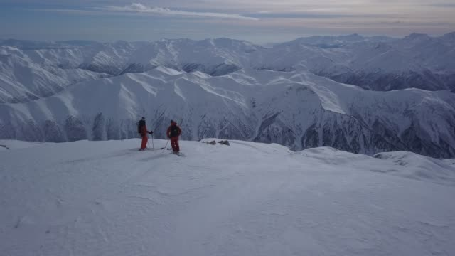 Back country skiers standing on mountain top