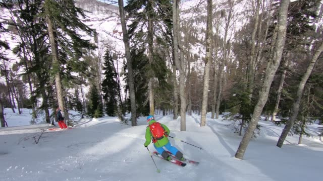 back country skiing down mountain - ski jacket stock videos & royalty-free footage