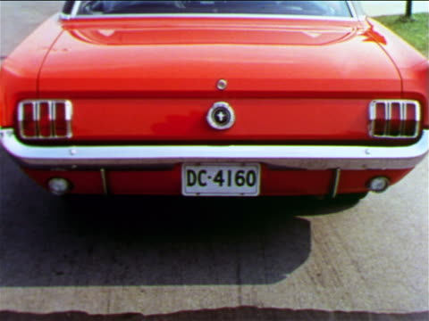 1965 rear view back end of red ford mustang with turn signal light blinking / industrial - ford mustang stock videos and b-roll footage