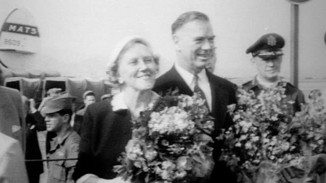 back in asia as a special envoy of president eisenhower general van fleet and his wife helen van fleet are greeted by crowds upon their arrival - corea del sud video stock e b–roll