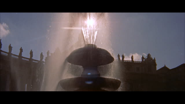 ms back lighted fountain in saint peters square / rome, italy - fountain stock videos & royalty-free footage