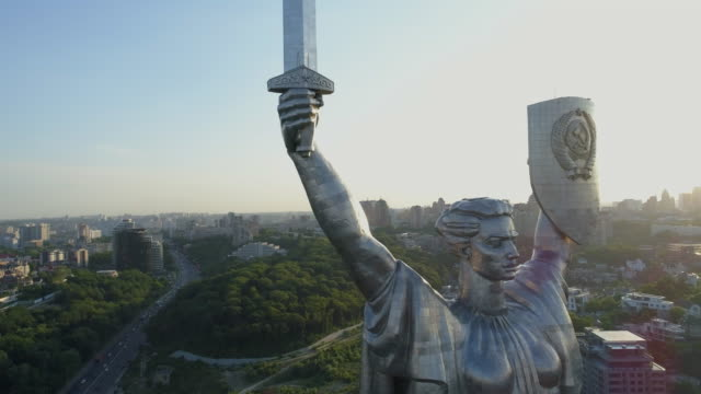 back lit close up aerial view of motherland monument in kiev - キエフ市点の映像素材/bロール