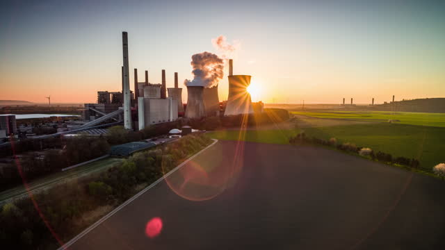 back lit coal fired power station - aerial shot - power station stock videos & royalty-free footage