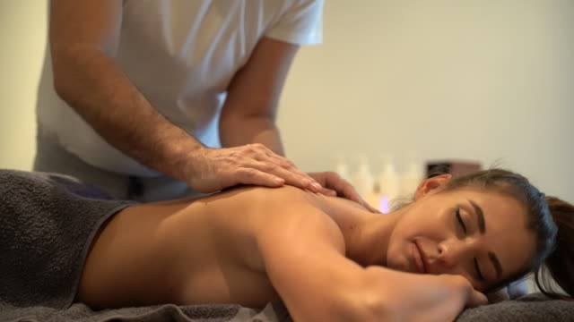 back massage at the spa - body care stock videos & royalty-free footage