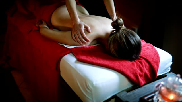 back massage in spa centre - massage stock videos & royalty-free footage