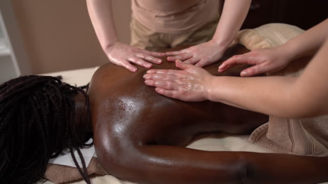 back massage treatment - stock video - masseur stock videos & royalty-free footage