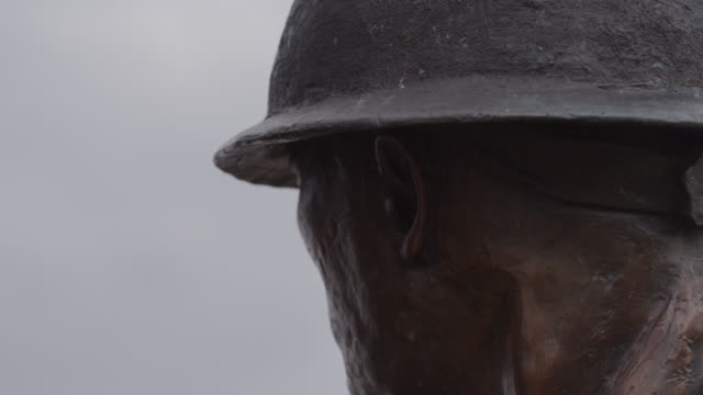 Back of a construction worker's head, wearing a hard hat in a bronze statue entitled, 'Labor' by Matthew Placzek.