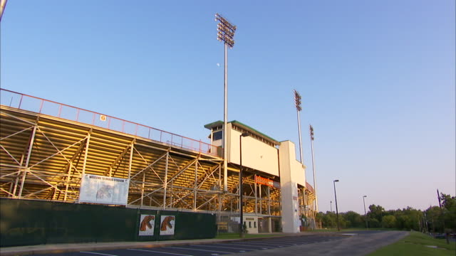 Back of bleachers w/ announcer booth on top tall light poles Football Rattlers NCAA Marching 100 Band