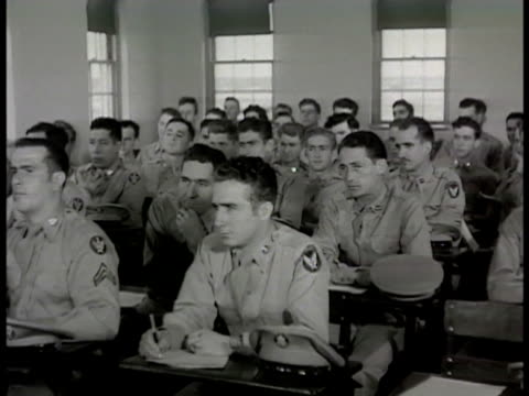 vídeos de stock, filmes e b-roll de air force flight training class student pilot in uniform at blackboard w/ instructor mechanic technician instructor using pointer on moving b29... - 1948