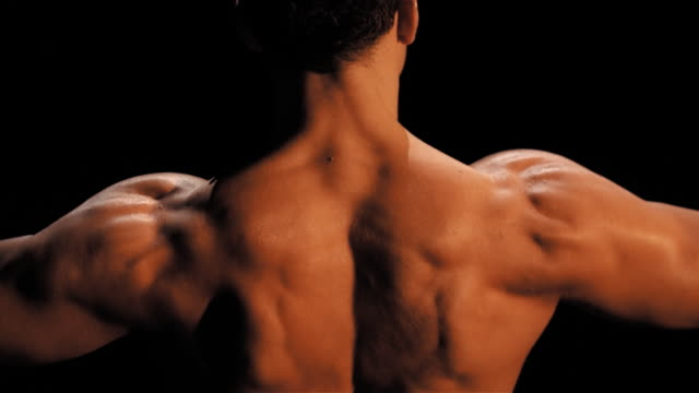 back of man flexing - flexing muscles stock videos & royalty-free footage