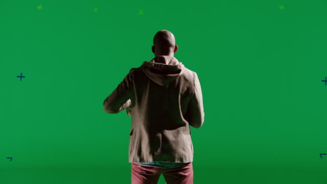 MS Back of man singing in front of green screen