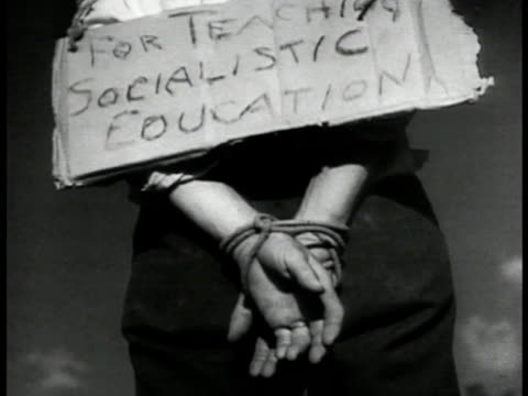 dramatization back of mexican male hanging w/ hands bound behind him amp sign 'for teaching socialistyc [sic] education' buzzards standing on rocks... - lynching stock videos & royalty-free footage
