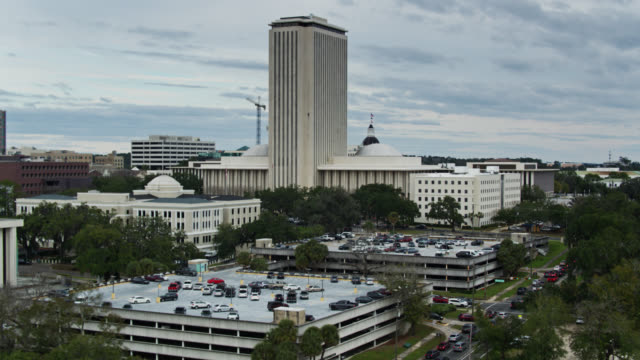 back of new state capitol and donald l. tucker civic center in tallahassee, florida - aerial - florida us state stock videos & royalty-free footage