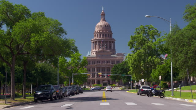 back of the capitol building in austin on a spring day - austin texas stock videos & royalty-free footage