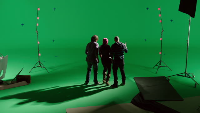 CS Back of trio singing in front of green screen