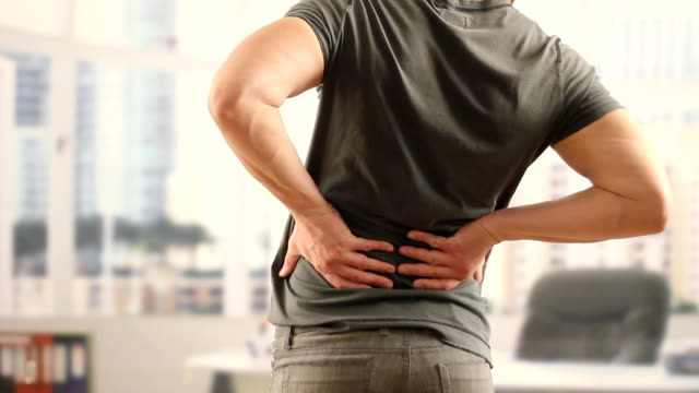 back pain - stretching stock videos & royalty-free footage