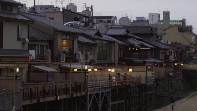 ms zo ha back part of pontocho alley and promenade at kamo river at dusk, kyoto, japan - kyoto stock videos and b-roll footage