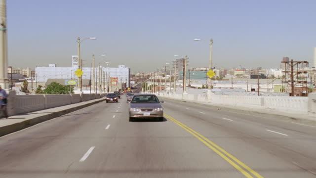 WS Back POV Shot of cars running on fourth street bridges / Los Angeles, California, united states