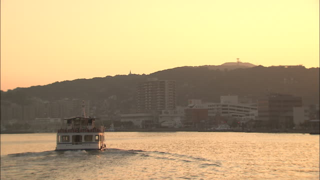 A back shot of Wakato Ferry sailing from the foreground to the back, Japan