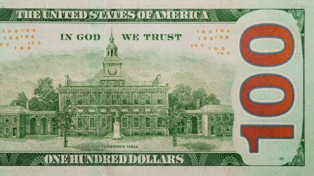 back side of $100 dollar bill currency of the united states of america - independence hall stock videos & royalty-free footage