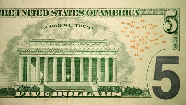 vídeos y material grabado en eventos de stock de parte trasera de $5 dollar bill currency de los estados unidos de américa - billete de cinco dólares estadounidense