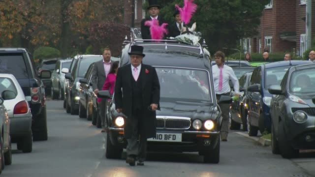 funeral england manchester ext funeral cortege of kirsty howard who was born with her heart back to front and who raised millions for charity along... - carro funebre video stock e b–roll