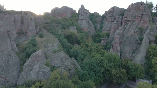 back to nature. aerial view over a tourist hiking in the red rocks of belogradchik mountains. enjoyment outdoors on a sunny day during the covid-19 pandemic. unesco world heritage site. - named wilderness area stock videos & royalty-free footage