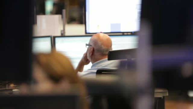 back view a financial trader monitors data on computer screens at the frankfurt stock exchange in frankfurt germany on thursday july 31 pull focus... - frankfurt stock exchange stock videos and b-roll footage