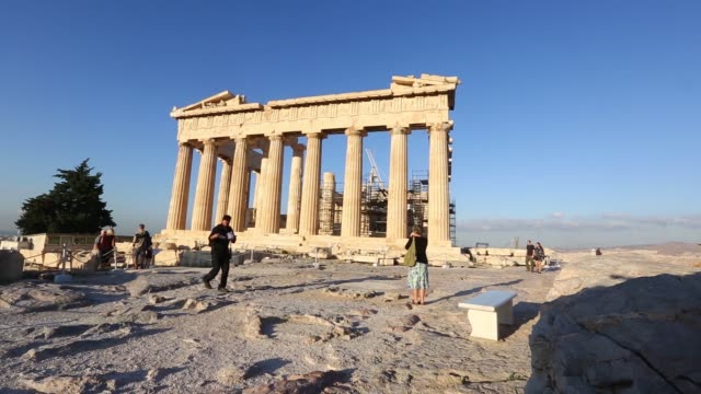 Back view a male tourist walks towards the Parthenon at the Acropolis in Athens Greece on Tuesday Sept 30 Side view of the Parthenon A female tourist...