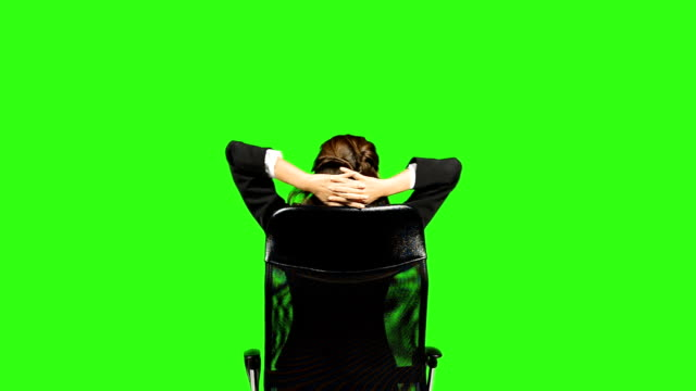 back view of business woman with arms crossed behind head - keyable stock videos & royalty-free footage