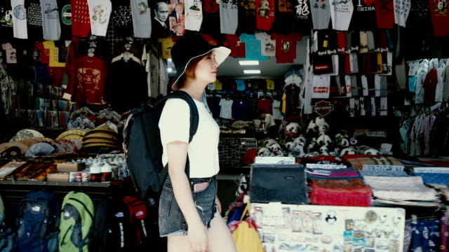 back view of female tourists visiting the traditional market,xi'an,china. - exoticism stock videos & royalty-free footage