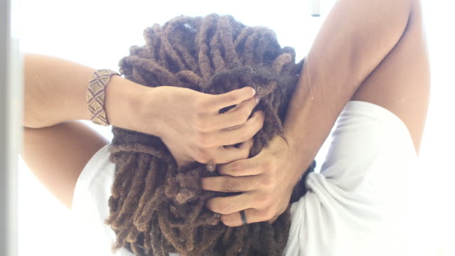 back view of unrecognizable rastafarian man stretching his arms and neck - rastafarian stock videos & royalty-free footage