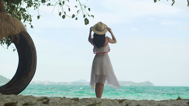back view of vacation asian young female age 27 yearold tourist on summer enjoying travel holidays at resort in phuket thailand whlie she looking at view on ocean.she's enjoying sunny day on the beach.phuket, thailand concept. - wonderlust stock videos & royalty-free footage